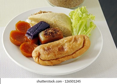Different glutinous sweet rice cake on a plate