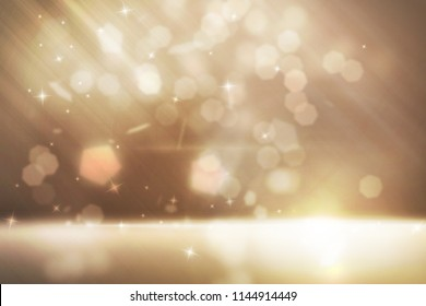 Different gold sparkles effect floating and have soft light floor at below scene with glitters falling on gold back ground