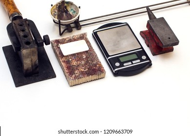 Different goldsmiths tools on the jewelry workplace. Desktop for craft jewelry making with professional tools. Aerial view of tools over isolated white background. Tabl repair goldsmith