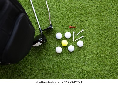 Different golf clubs, balls and tee on the green grass background.Golf set concept.Sport equipment.
