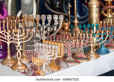 Different Hannukah menora and other candlesticks at the flea market