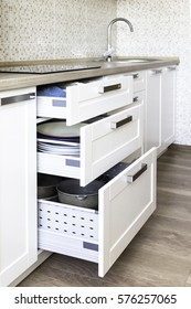 Different height opened drawers for all kind of kitchen stuff for best organization and storage