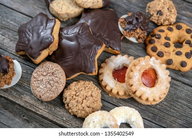 different homemade cookies on gray wooden ground
