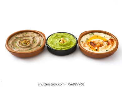 Different hummus bowls. Chickpea hummus, avocado hummus and lentils hummus isolated on white background