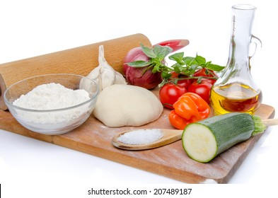 Different ingredients to make a pizza, isolated on white