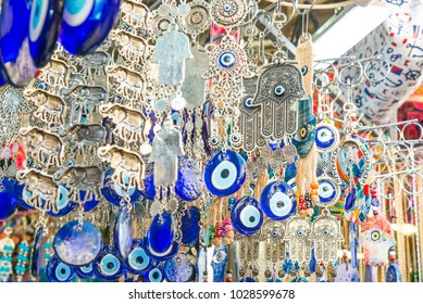 Different jewish souvenirs as Hamsa with Shalom (Peace) and other sale at the popular marketplace in Tel Aviv, Israel. Selective focus