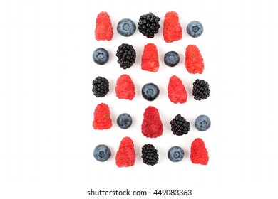 different juicy berries laid out in a square on a white background