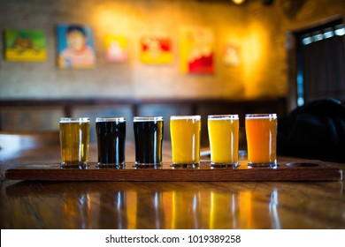 Different kind of beers in one line on the table