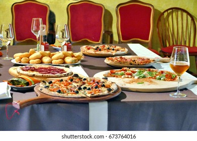 Different kind of pizzas served on table