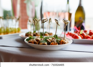 Different kind of snaks, small canape with cherry tomatoes, cheese, sausages, vegetables and fruits on skewers