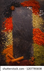 Different kind of spices on dark background. Food frame, top view, copy space.