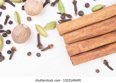 Different kind of spices on wooden background