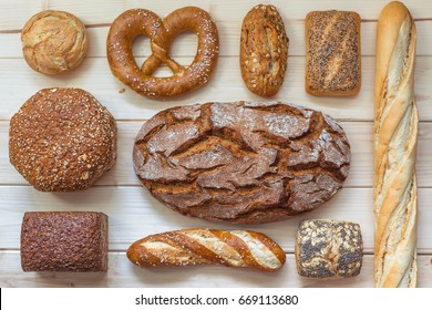 Different kinds of bread, top view, bright background