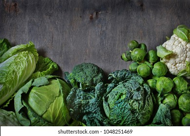different kinds of cabbage background. Copy space. broccoli, brussels sprouts, cabbage, Savoy cabbage, cauliflower, Peking cabbage. The concept of healthy diet food. Flatlay.   top view