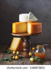 different kinds of cheese with jam and plums