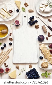 Different kinds of cheeses, figs and other ingredients for cheese snacks. Background, top view, space for your text, menu, recipe