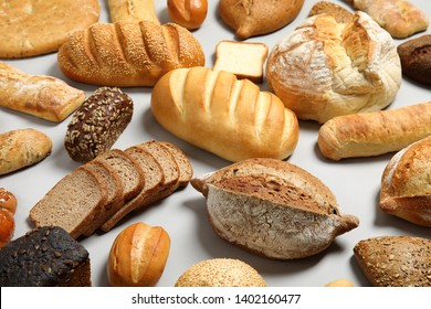 Different kinds of fresh bread on light background