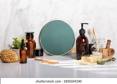 Different kinds of hygiene and cosmetic products near white marble wall in bathroom, zero waste concept