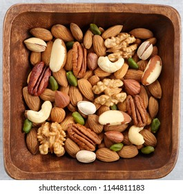Different kinds of nuts in wooden bowl. Healthy food.