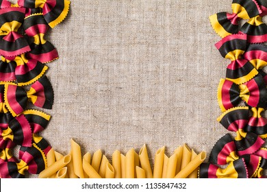 Different kinds of pasta. space for text. Various mix of pasta. Flat lay raw spilled Italian pasta. Diet and food concept.