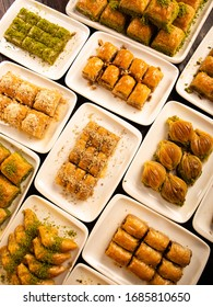 Different kinds of Turkish dessert baklava on the table.