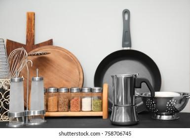 Different kitchen utensils on table in kitchen