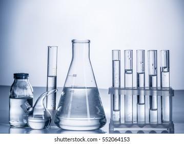 Different laboratory beakers and glassware. Monochrome.
