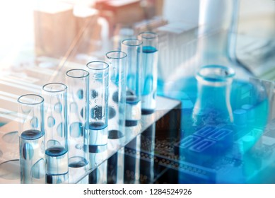 Different laboratory glassware with color liquid and with reflec