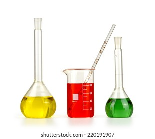 Different laboratory glassware with colored liquid isolated over white background