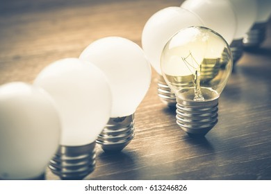 Different light bulb standing out of the row
