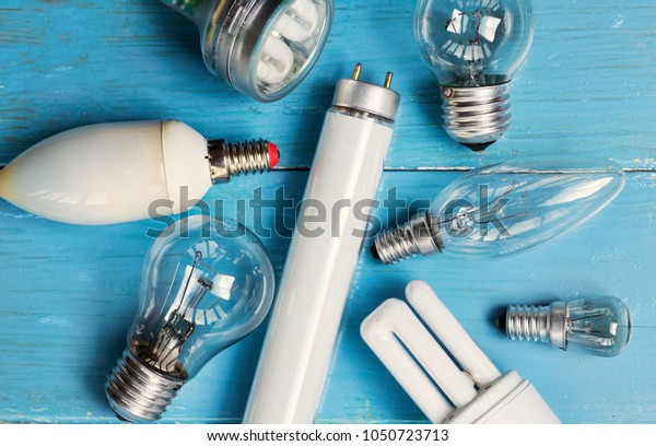different Light bulbs on wooden. Earth hour message card