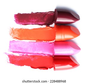 Different lipsticks isolated on white