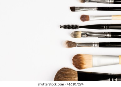 Different make up brushes are on white background.