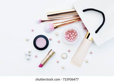 Different makeup beauty cosmetic in gift package on white background