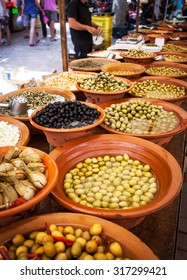 Different marinated olives and local food on street market in Mallorca, Spain. Selling and buying.