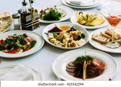 Different meals for the guests on the wedding table