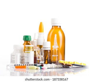 Different medicament in bottles, ampules and tablets with insulin syringe  on white background