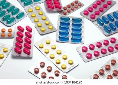 Different medicines NSAIDS group in blister strip packs on white background. Isolated and selective close-up focus.