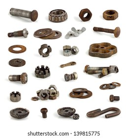 Different metal parts and tools on white background.