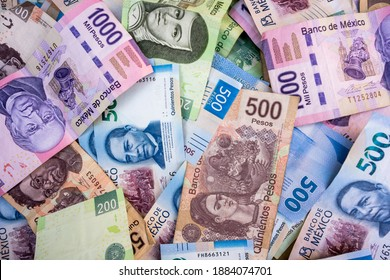 Different Mexican banknotes, placed one on another.