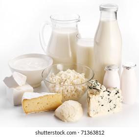 Different milk products: cheese cream, milk, yogurt. On a white background. Dairy concept.