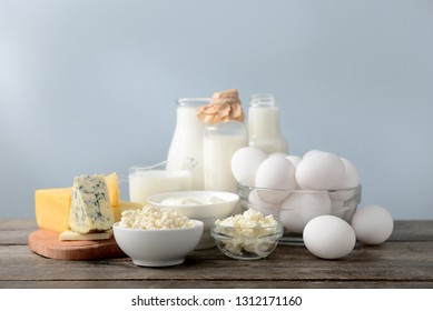 Different milk products with eggs on wooden table