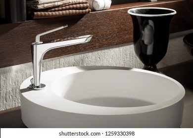 Different and modern design basin mixer. Round sink and stylish design.