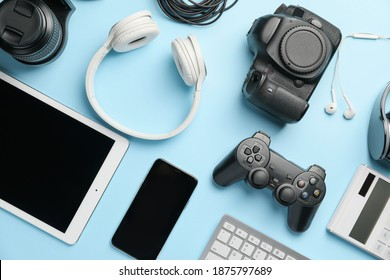 Different modern devices on color background - Shutterstock ID 1875797689