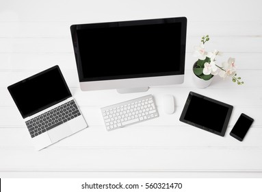 Different modern gadgets on desk, view from above