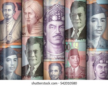 Different money bills stacke over each other forming a money wall.
