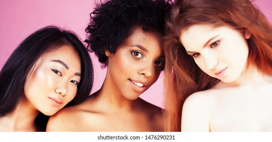 different nation woman: african-american, caucasian, asian together on pink background happy smiling, diverse type on skin, lifestyle people concept