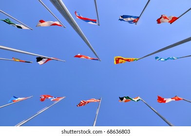 Different national flags and sky background
