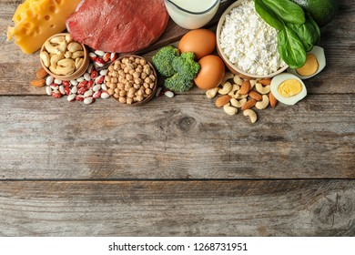 Different natural food on table, top view with space for text. High protein diet
