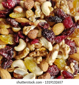 different nuts and dried fruits vegan food background